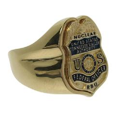 Custom U.S. TVA badge top ring shown in 10k gold